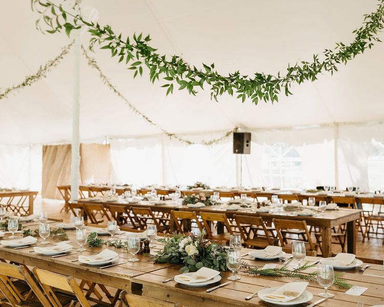 Rustic elegant farm tables and chairs in the tent pavilion | Justine Montigny Photography