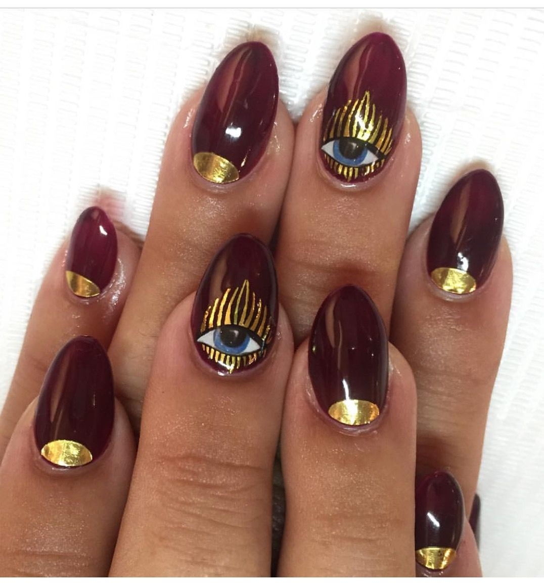 Burgundy Nail With Gold Eye Art