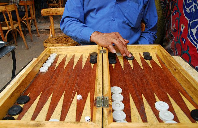 Tawle1 cairo an egyptian plays backgammon known in egypt as tawle in a coffee shop in old islamic cairo publicscrutiny Choice Image