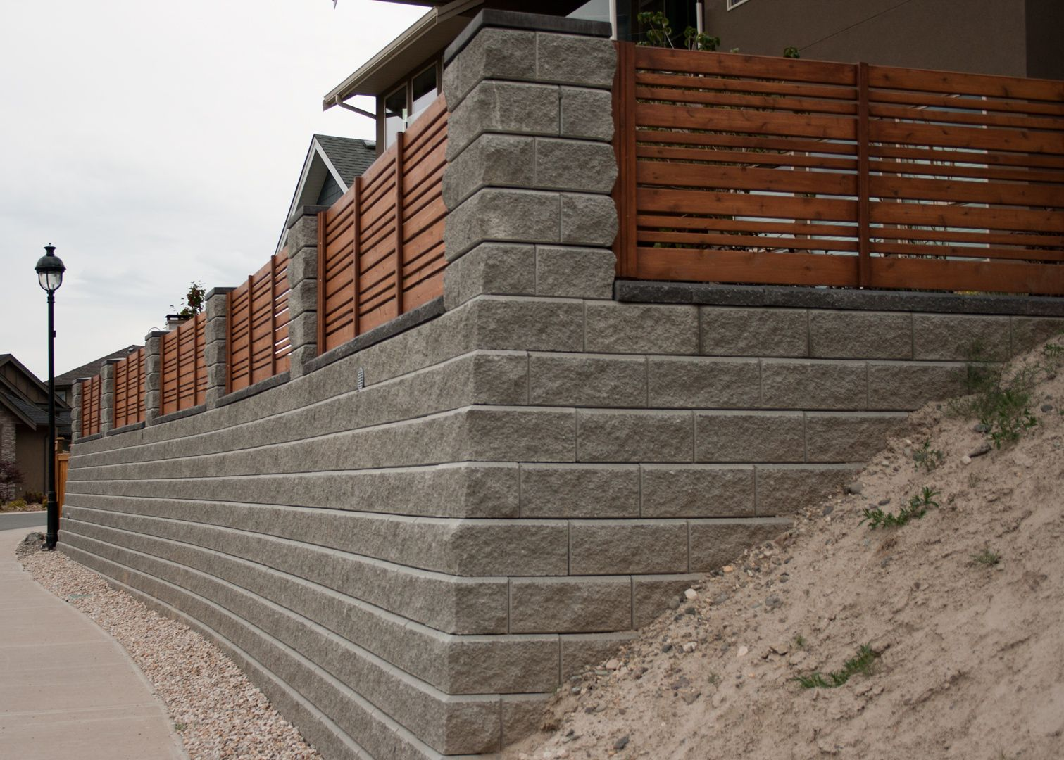 A Fair Price For A Job Well Done Wood Fence Retaining Wall Concrete Blocks