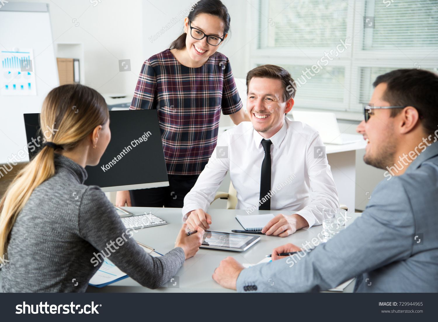 Group Of Business People At A Meeting In The Officebusiness Group