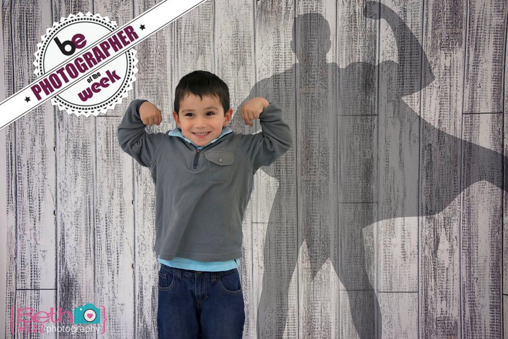 """Congrats to Photographer of the Week: Beth Hill Photography! This adorable """"superkid"""" was photographed on our Whitewash Wood Backdrop."""