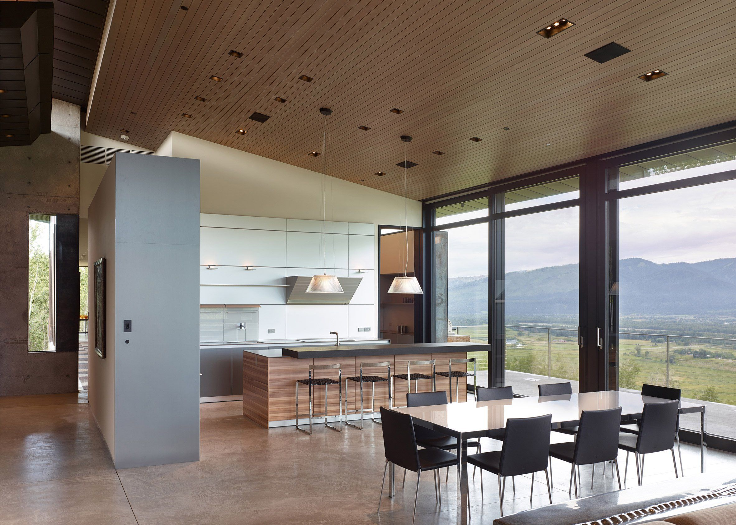 Floor To Ceiling Windows Which Frame Views Of The Scenic Terrain Are