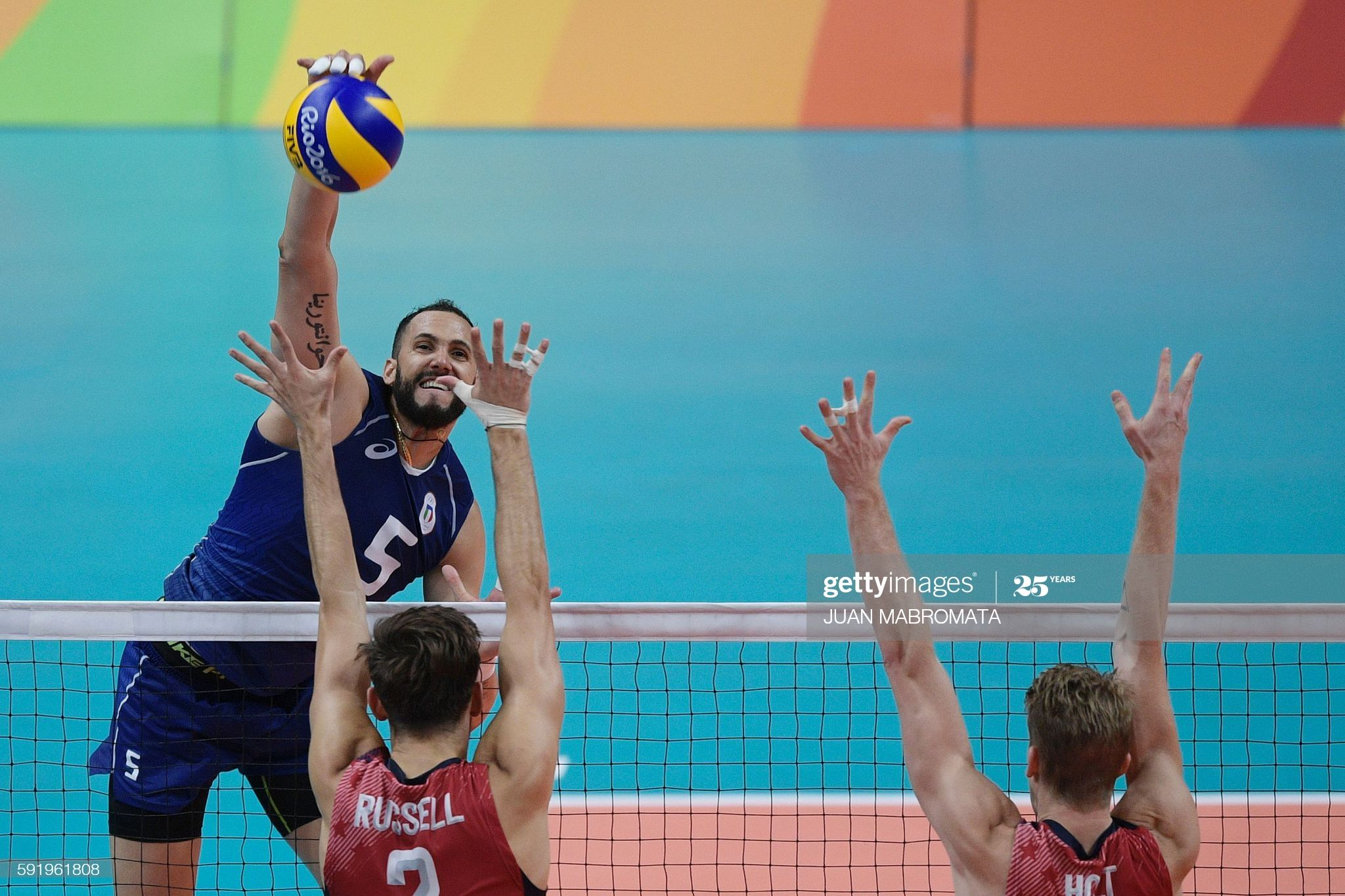 Italy S Osmany Juantorena Spikes The Ball During The Men S Semi Final In 2020 Semi Final 2016 Olympic Games Rio Olympics 2016
