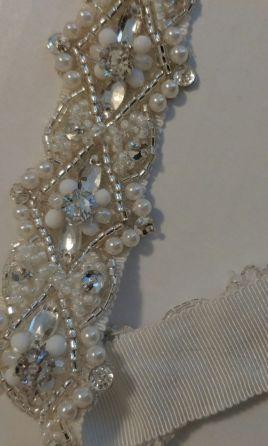 Used Wedding Sash/Belt For Sale, Ivory, Davids Bridal $90 USD Location: Marana, New (Un-Altered).