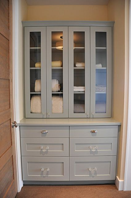 Build in shelves with glass doors and drawers rather than for Bathroom closet