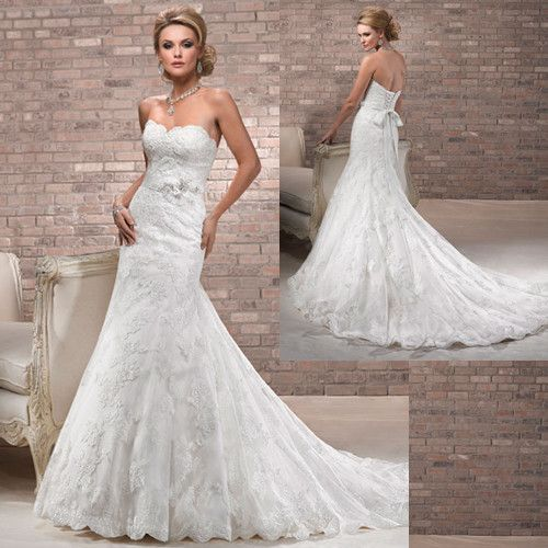 Maggie Sottero Lace Wedding Gown: Fit And Flare Lace Wedding Gown.