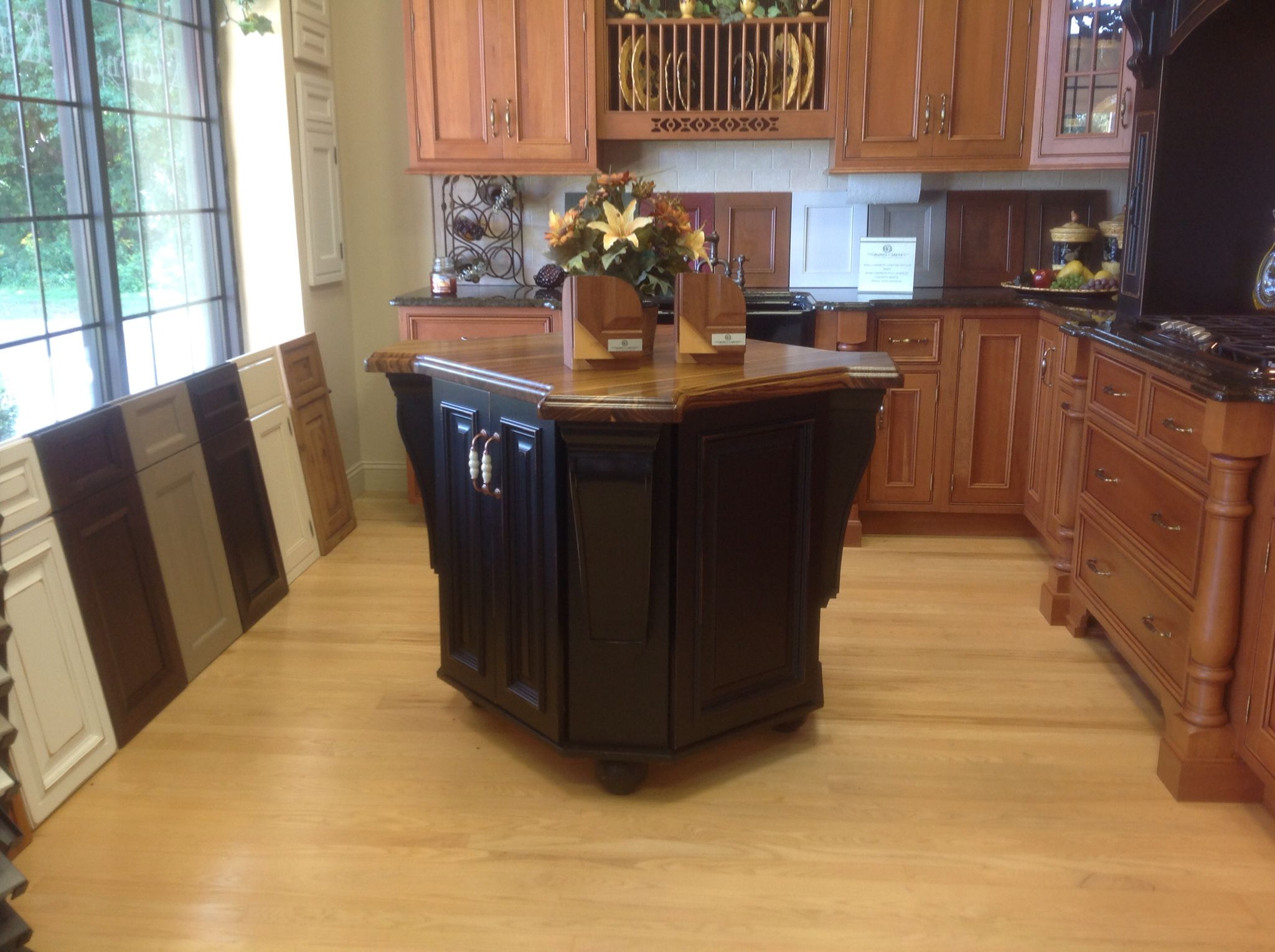 Custom Zebra Top Island Dyer S Cabinet Shop Is Having A Display Sale This Black Medallion Cabinet With Distress Medallion Cabinets Zebra Wood Custom Kitchen