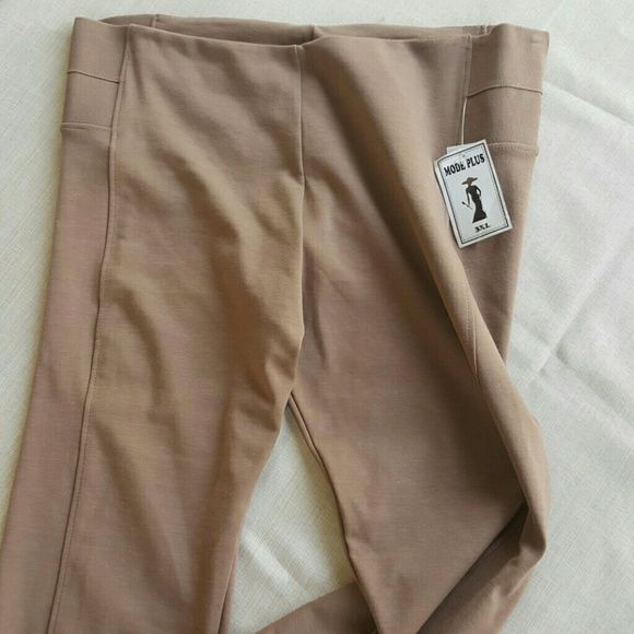 Great stretch pants Tan stretch pants with elastic accent on sides. Very comfortable.  NWT. 3x fit more like a 2x mode plus Pants Straight Leg