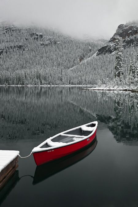 Canoe waiting for a hardy guest from Lake O'Hara Lodge to brave the cold and snowy morning