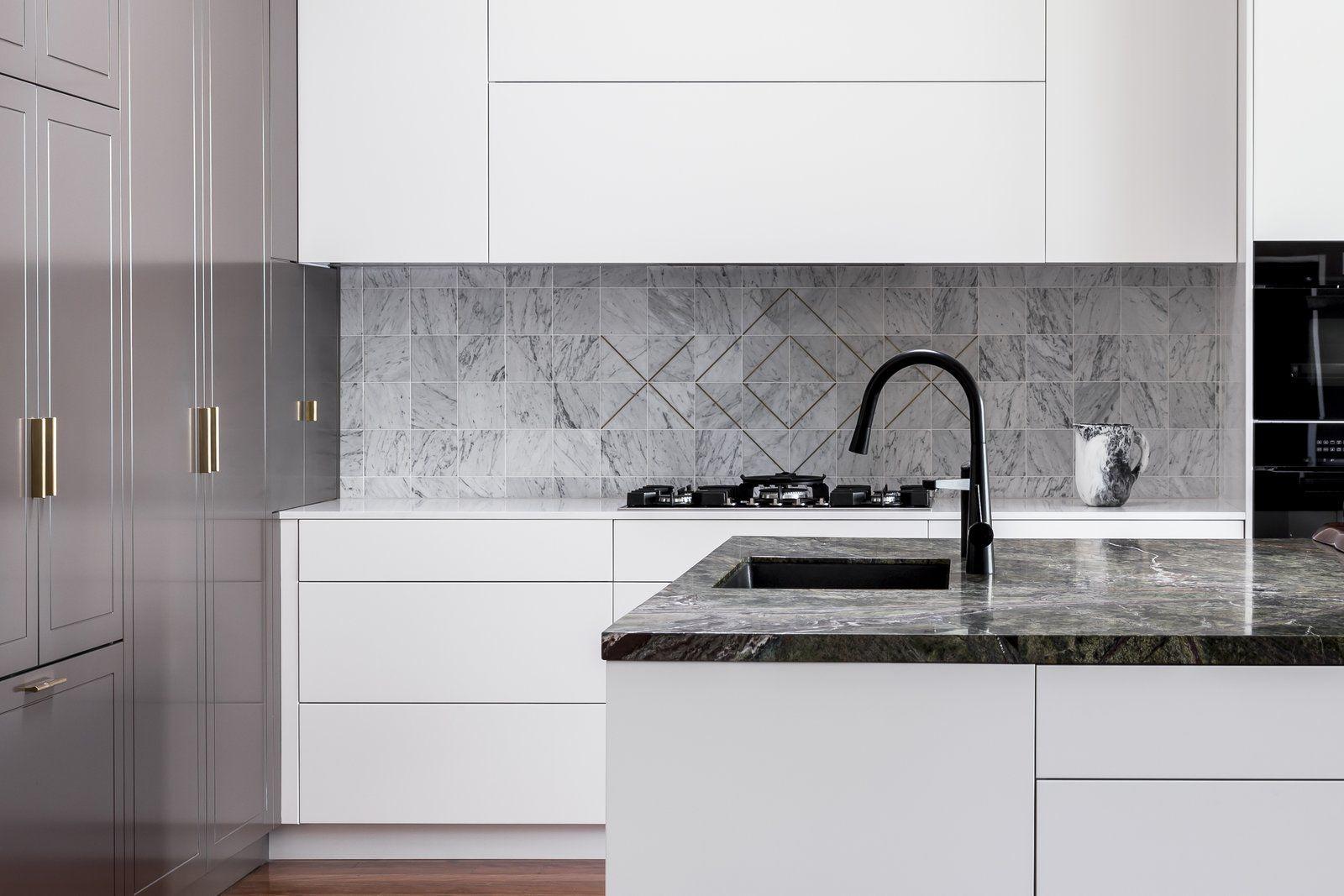 Kitchen dark hardwood floor undermount sink wall oven white