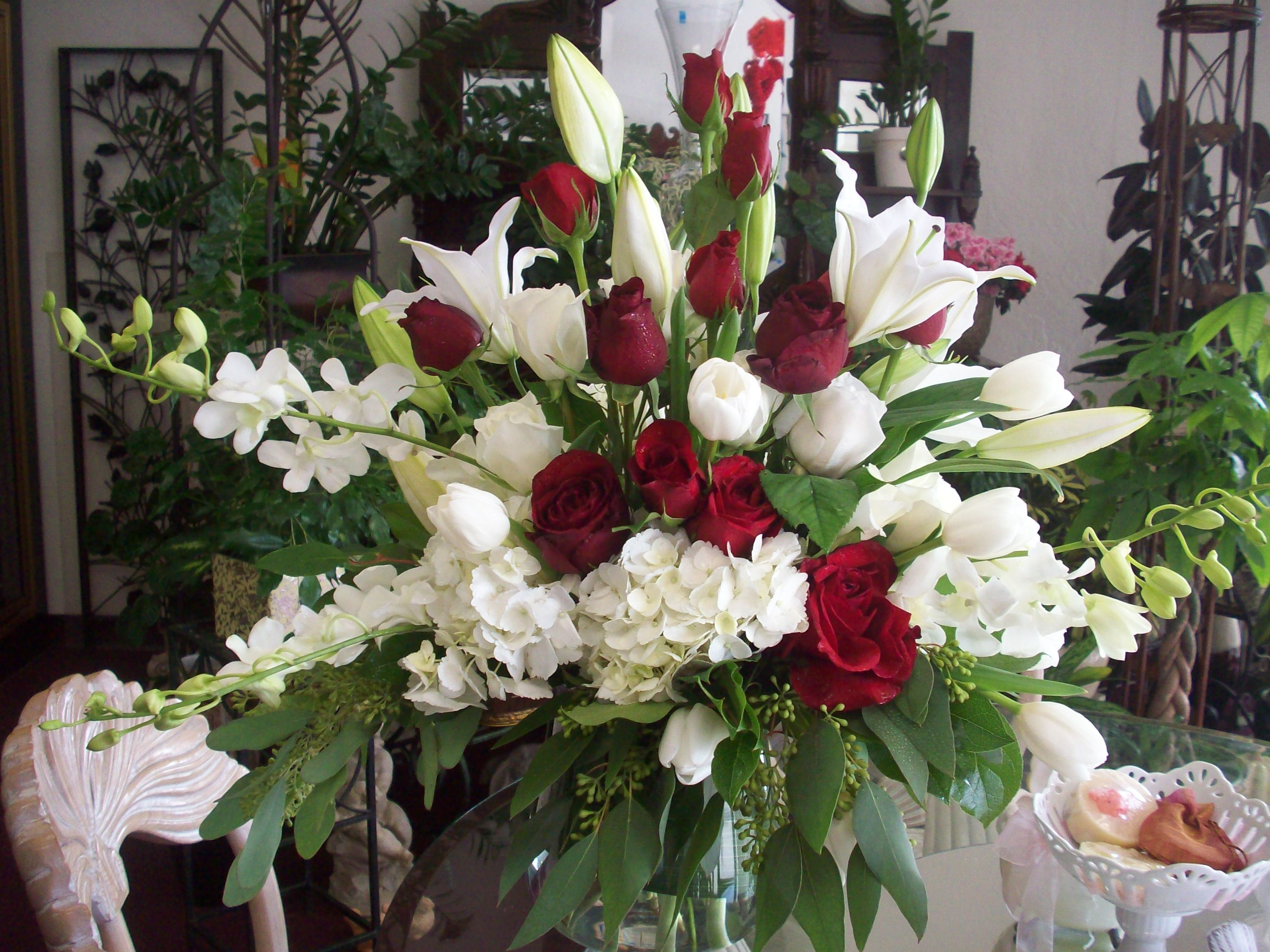 Red and white floral arrangement by Robyn