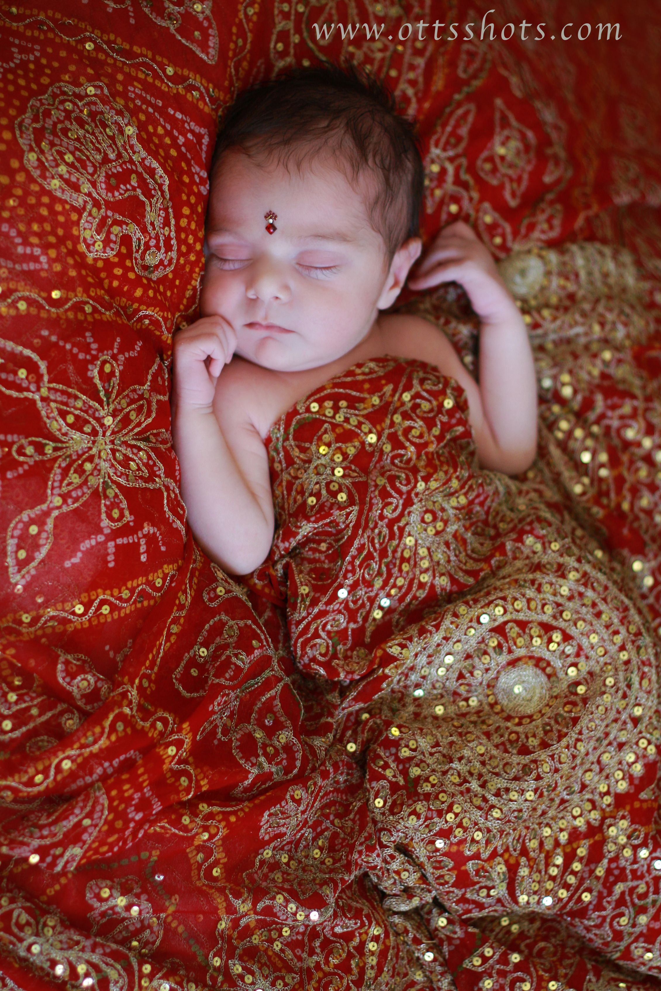 Newborn pictures on sari plan to do this with my wedding lengha for our next child