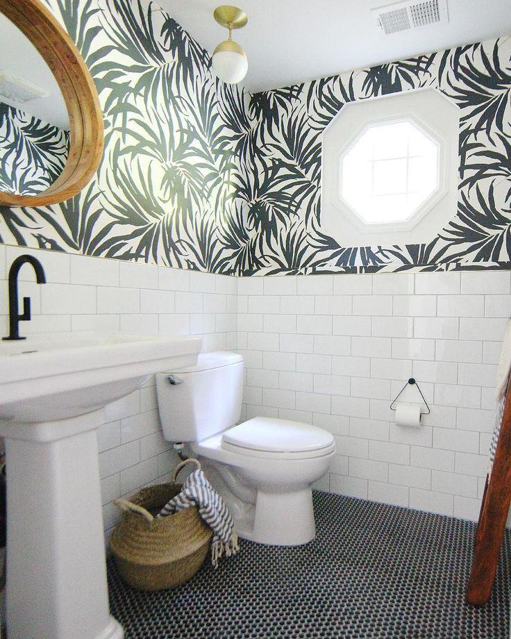 Black And White Bathroom Black Penny Tile On Floor White Subway Tile On Walls Palm Frond Wallpa White Bathroom Tiles Bathroom Makeover Bathroom Tile Designs