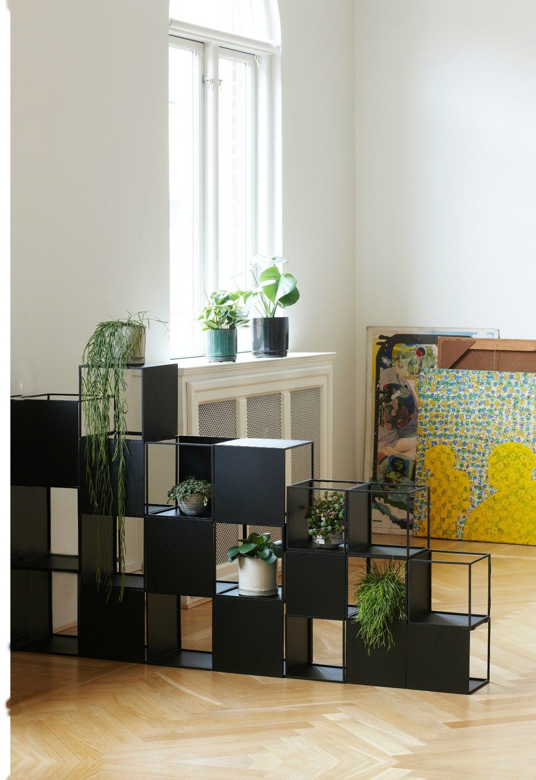 DIY Inspiration.  Stacked cube shelves used as storage & room divider.