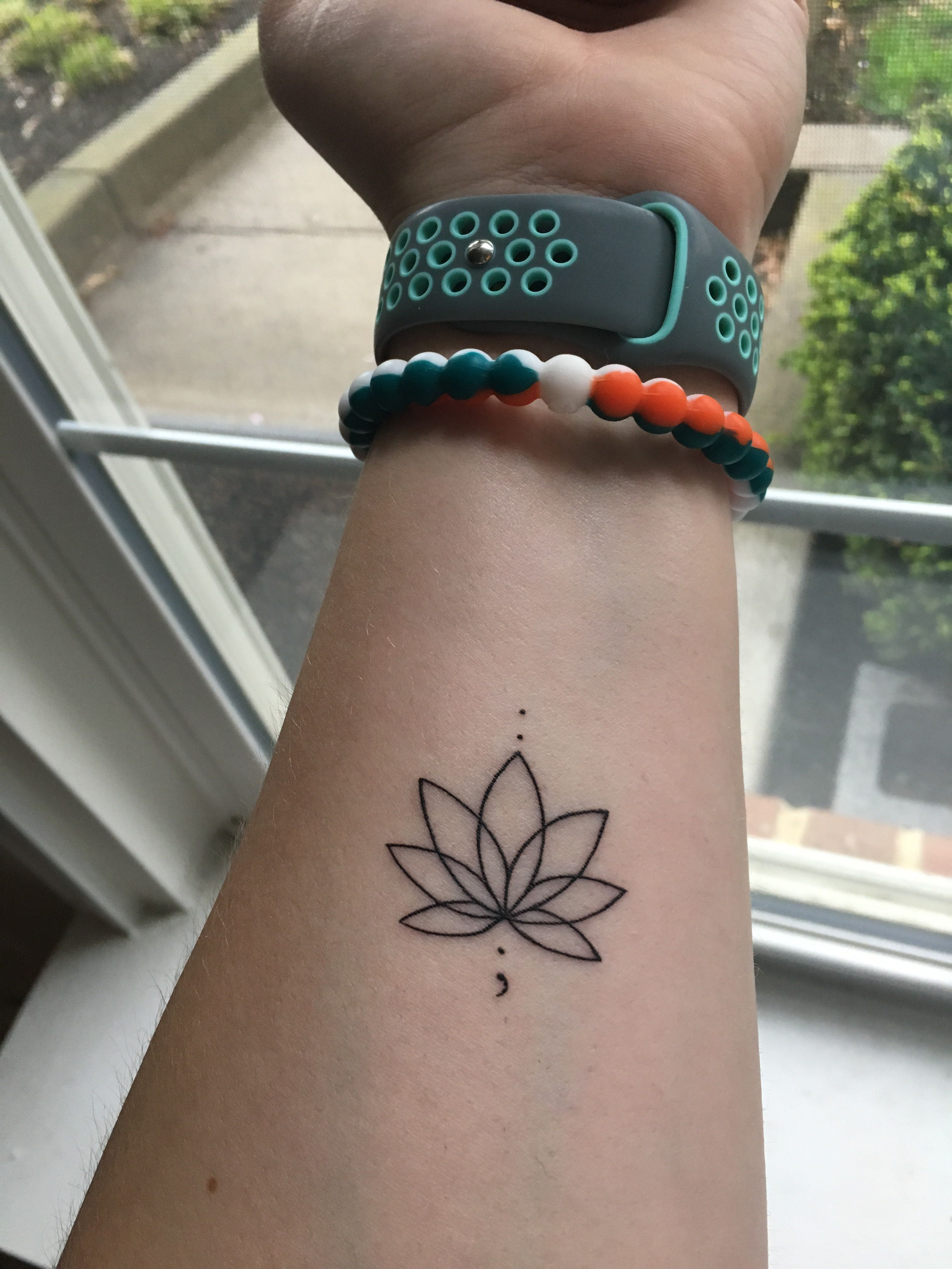 My first tattoo, a lotus flower with a semicolon