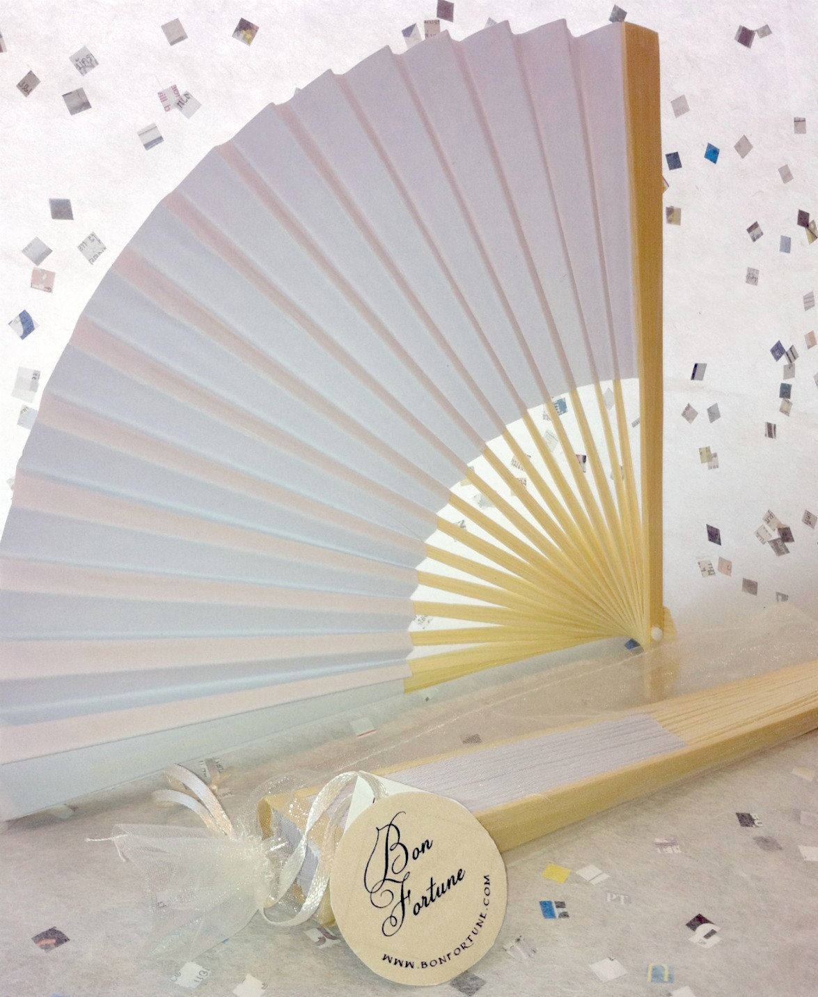 A white paper fan can be so classy at any wedding or event. Find ...