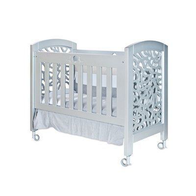 Collection Rosabel Leo Wooden Portable Crib With Mattress Finish: Silver