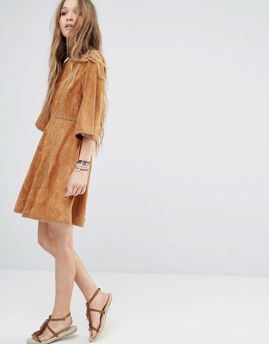 The Moon River Suede Mid Sleeve Dress With Trim is a fall must-have.