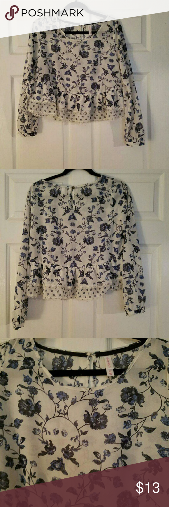 White and blue floral top White and blue floral top. Has a peplum ruffle detail. Super cute. Hate to see go, but I never wear it. No trades. Tops Blouses
