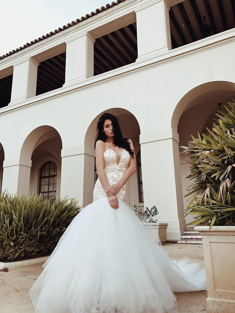 27093ecb She's a curve-hugging, sparkling mermaid wedding dress with the most  gorgeous floral sequin pattern, deep V illusion neckline and ...