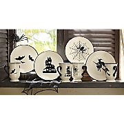 """$24.99 $19.99 4 pc halloween plate set -Set of 4 Plates: Includes haunted house, spider, witch and bat designs in black. Glazed white ceramic. Dishwasher and microwave safe. 8"""" diam., ea."""