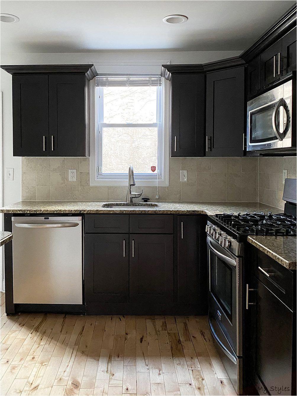 How Philadelphia Based Designers Fitz Water Interiors Updated A Dated Dark Kitchen While Keeping In 2020 Painting Kitchen Cabinets Dark Kitchen Cabinets Dark Kitchen