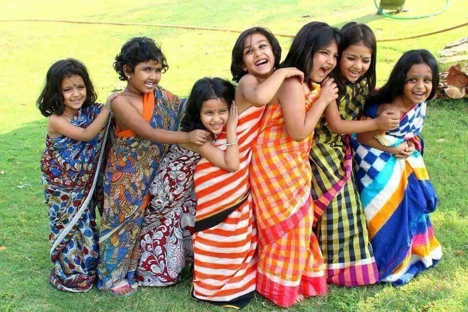 Laughing, smiling, happy girls wearing sarees
