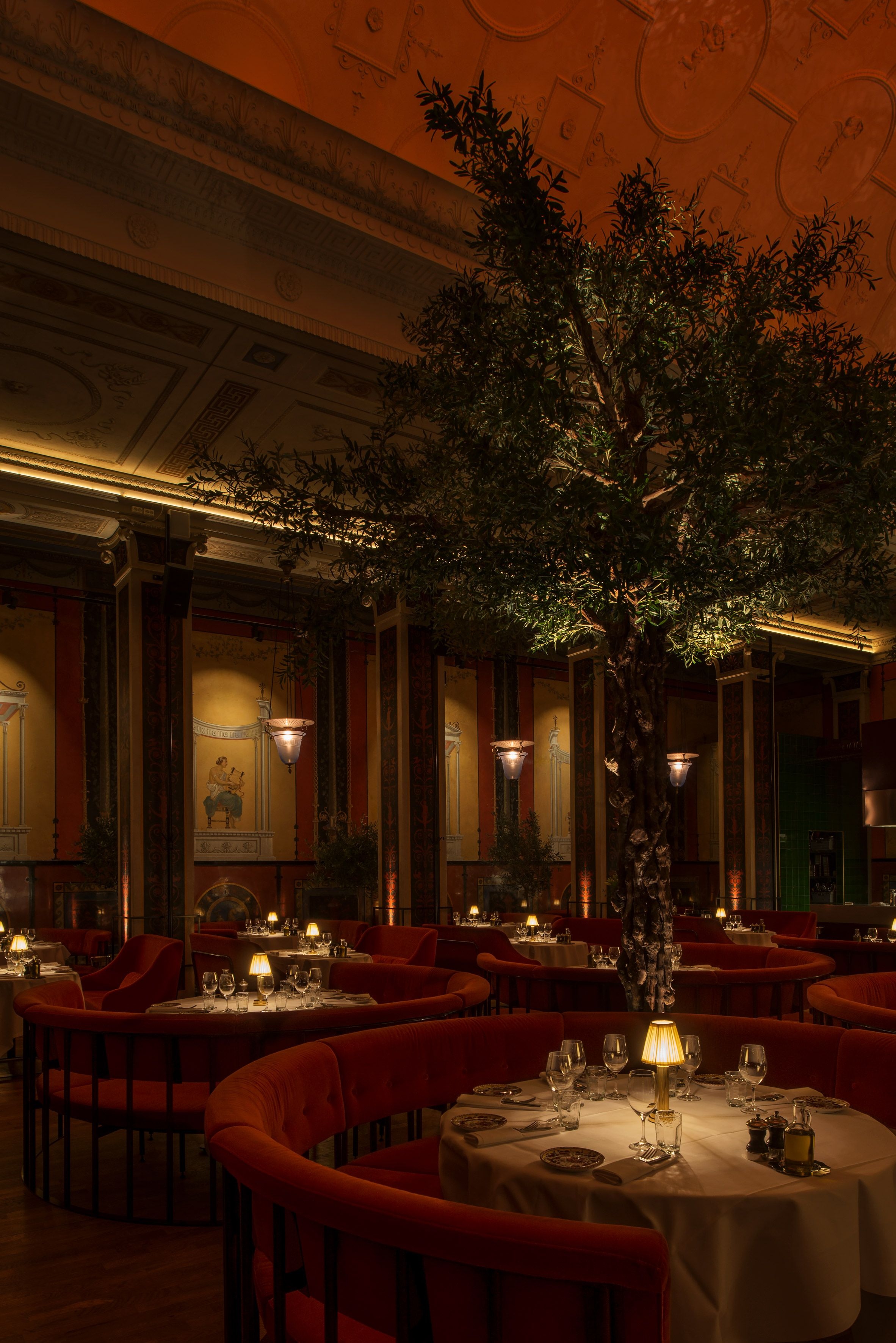 Ornately painted walls, velvet furnishings and a pair of olive trees ...