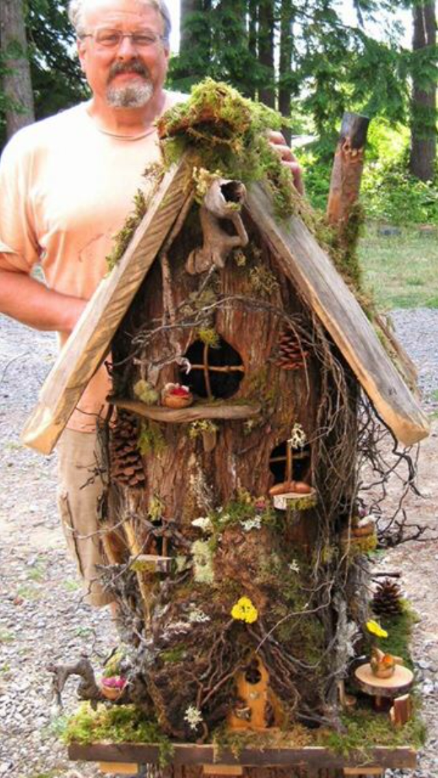 The ultimate fairy house made from a hollowed out tree stump.. This guy has some talent!