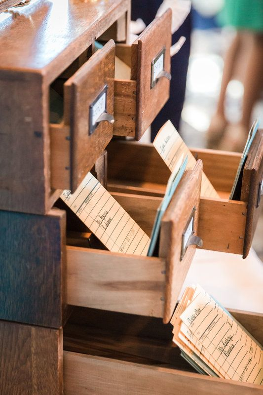 Card catalog seating cards for wedding | Education-themed wedding | Photo By Idalia Photography