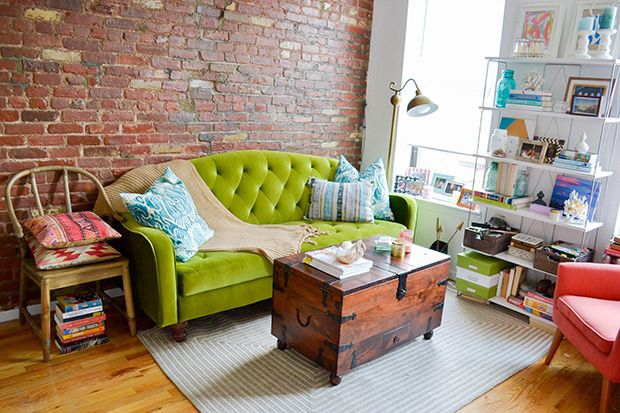 colorful nyc apartment living room with exposed brick