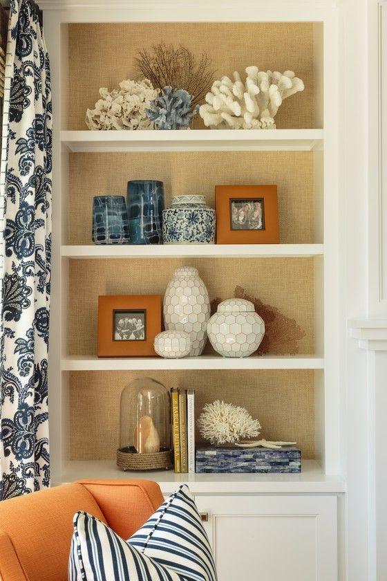 Blue and orange living room with coastal bookshelf styling - Blue and orange living room decor ...