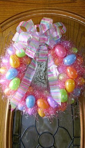 Photo of Easter wreath tutorial with plastic eggs and Easter grass. Adorable and simple!