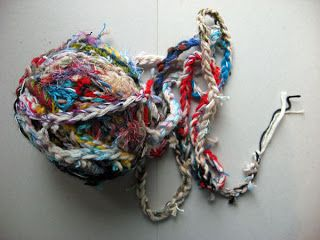 Ruth's weaving projects -braided bits of left over yarn to make a chunky weft yarn.