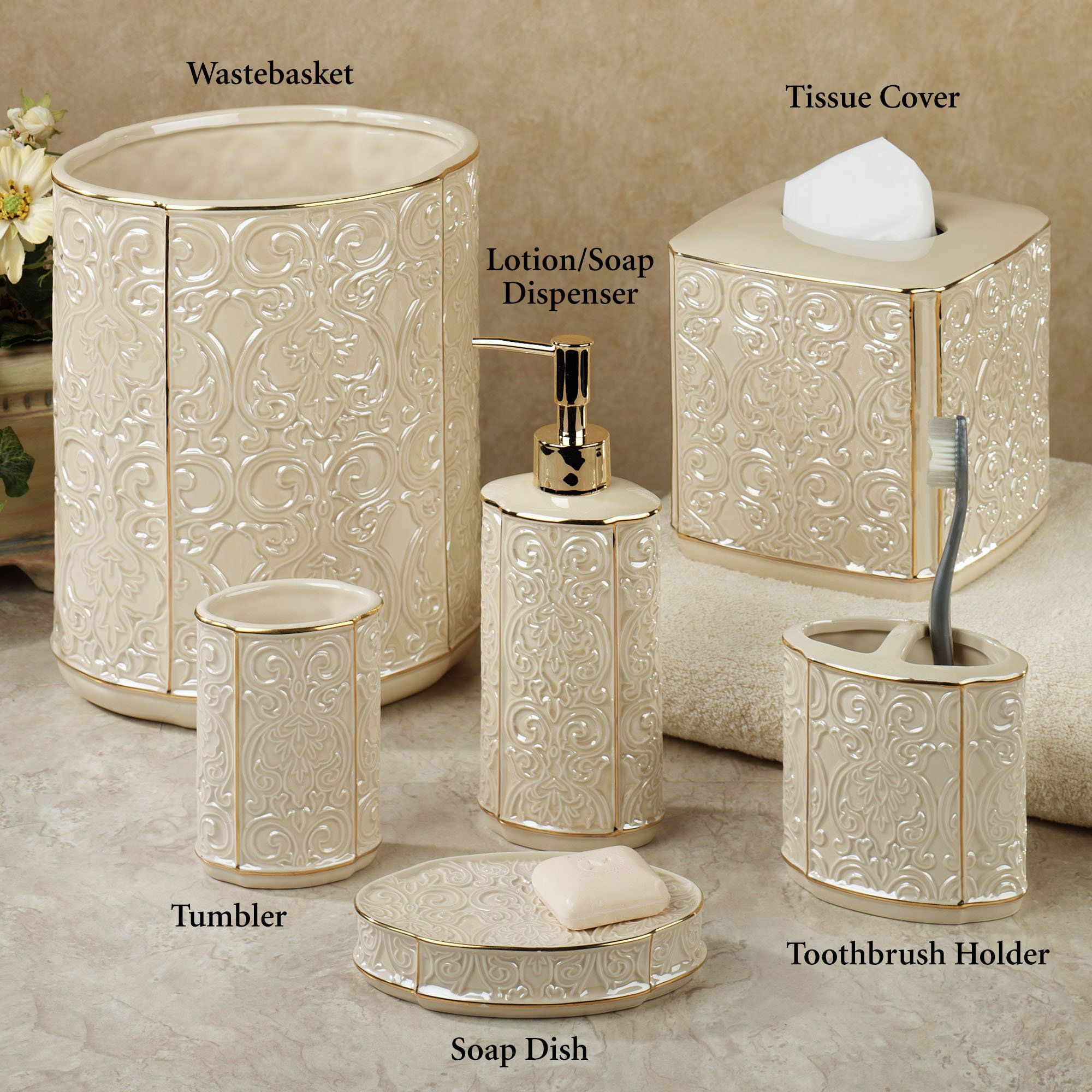 the cream furla damask bath accessories are painted ceramic with a gloss finish raised damask design and gold detailing on the edges