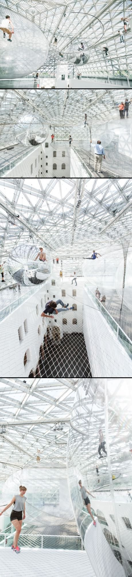 Artist Tomás Saraceno installed a 2500 square meters playground at a height  of 25 meters in Düsseldorf, Germany.