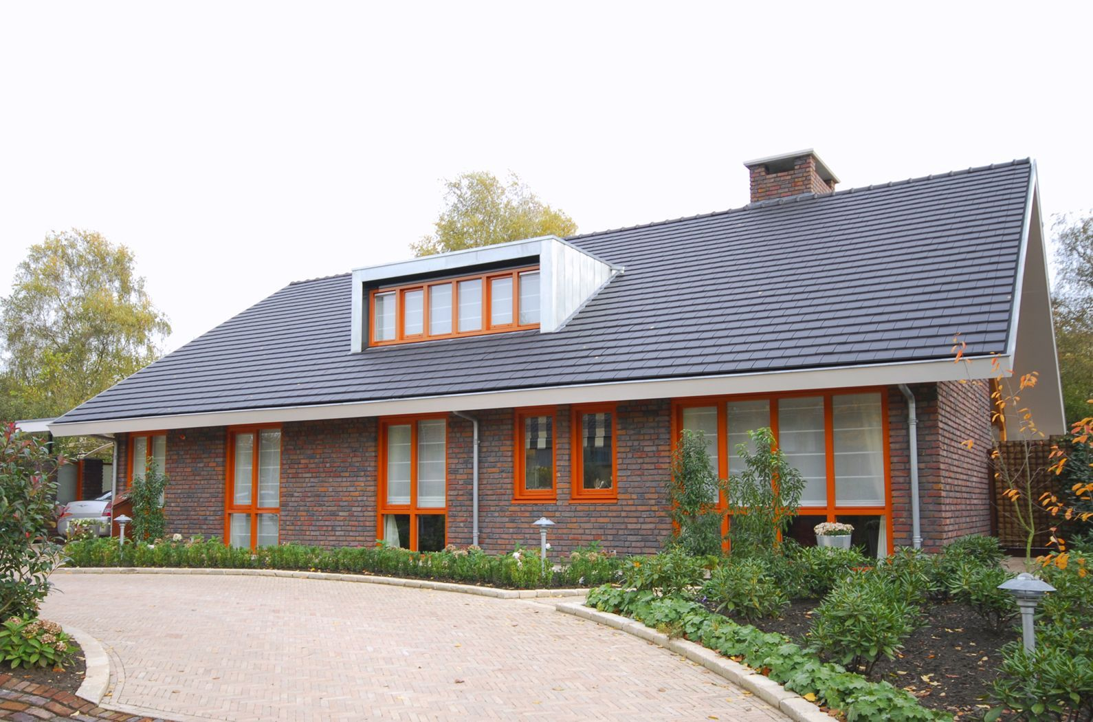 Modern Detached House Overhanging Gable Roof Bricks Walls