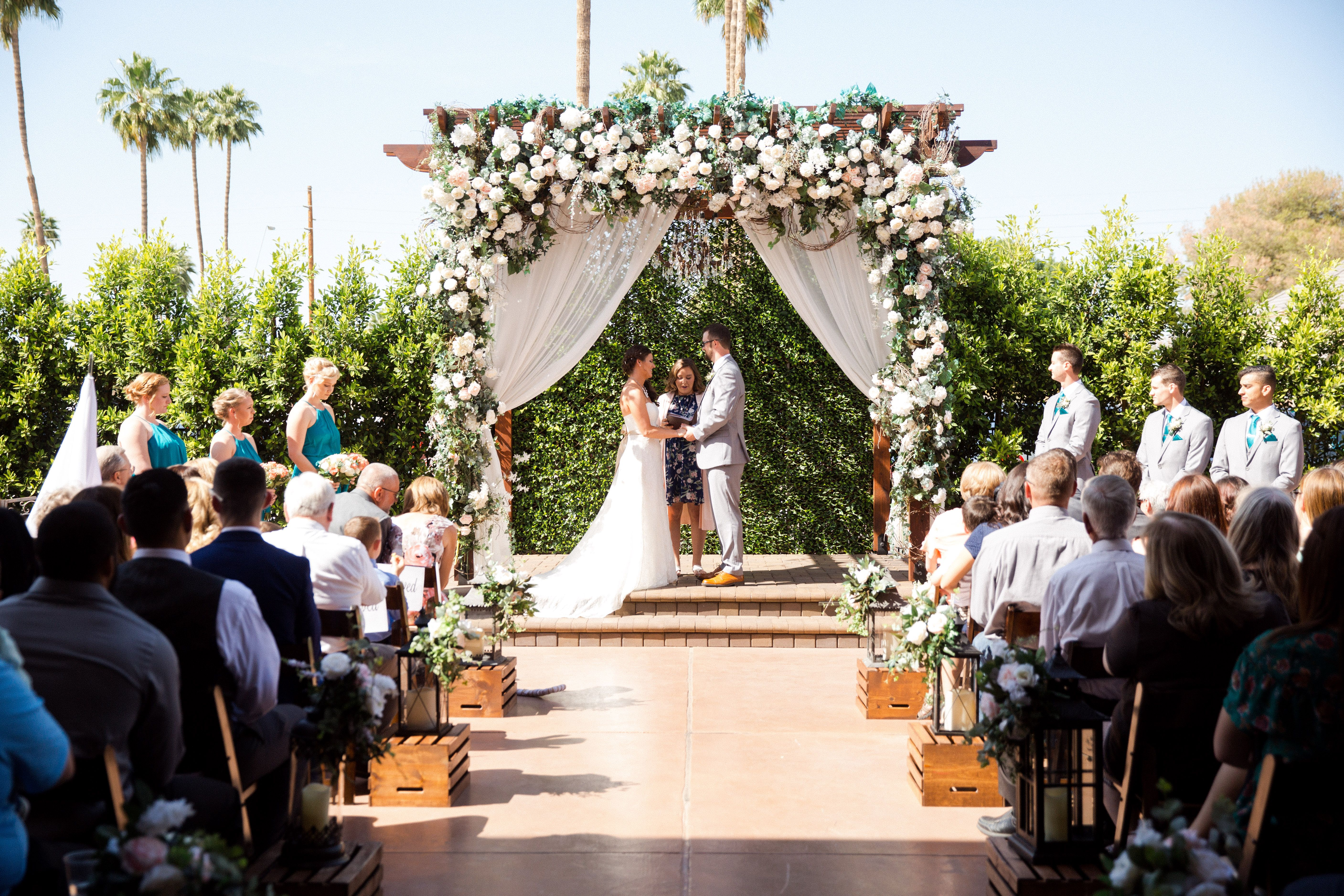 Country Courtyard Wedding Ceremony Decorated With Crates And Lanterns Lining