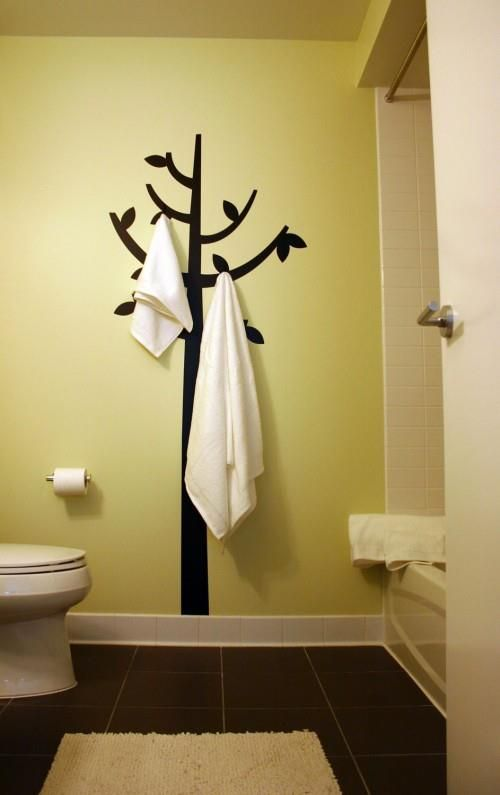 Idea: stagger individual steel or chrome towel hooks/pegs. No need ...