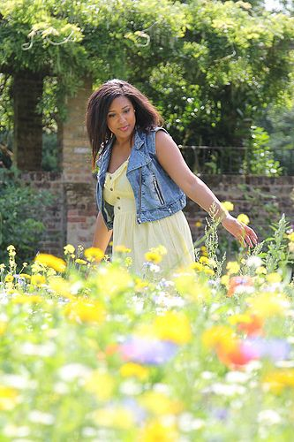 Ayisha walking through wild flower meadow