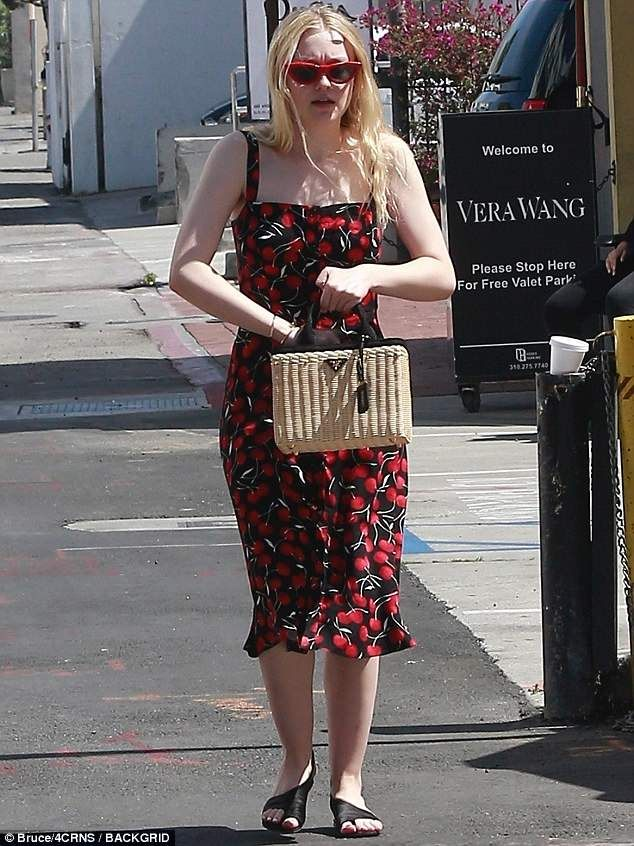 Dakota Fanning enjoys Beverly Hills stroll with her mother