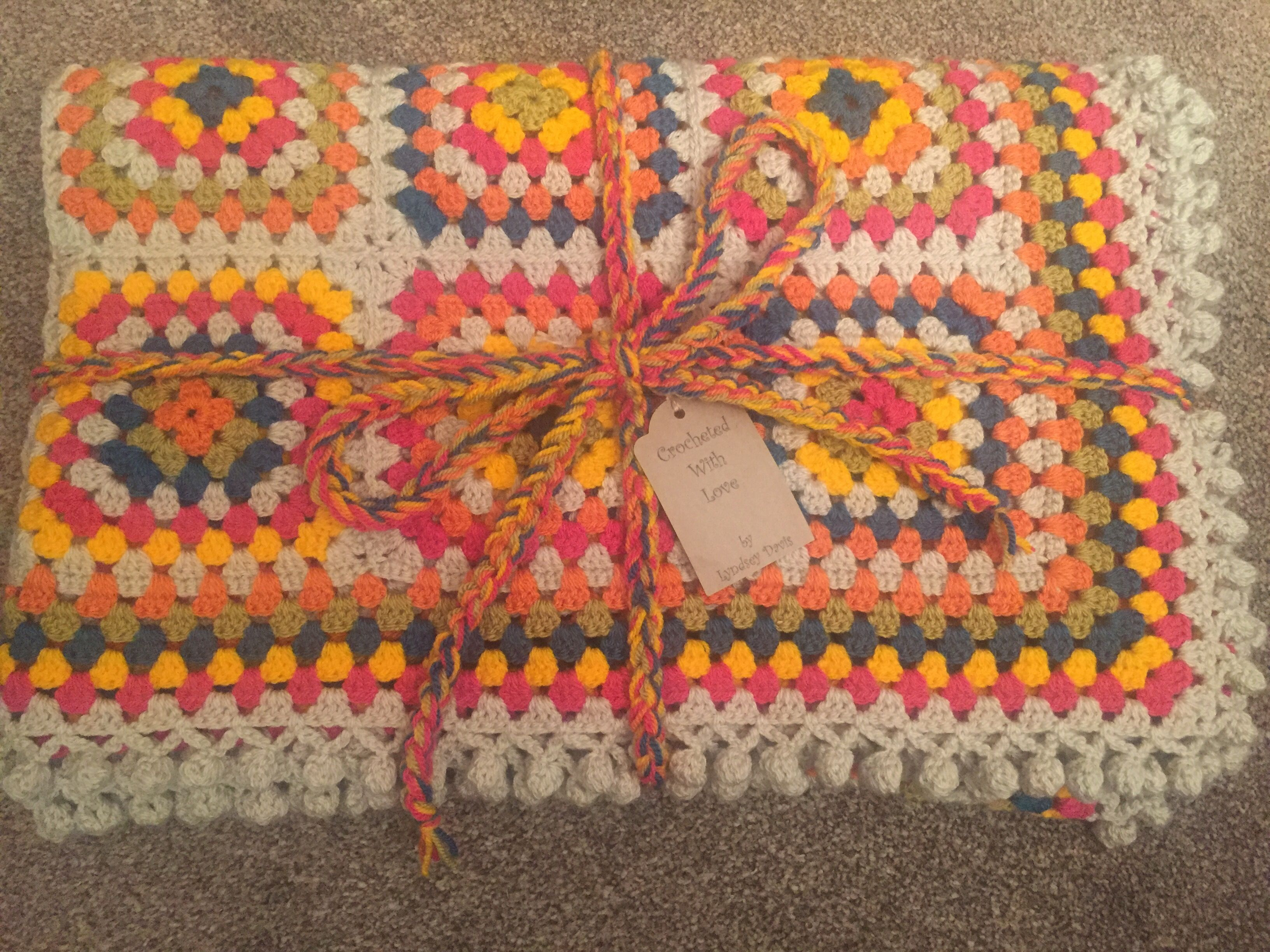 Large granny square blanket with Pom Pom edging that I made for Samantha's camper van