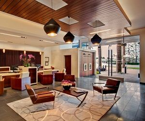 The overall space was given extra warmth through the use of stained rosewood veneer, stained alder ceilings, brown basalt stone paver and tile floors—all in keeping with the feel of the Manhattan Beac