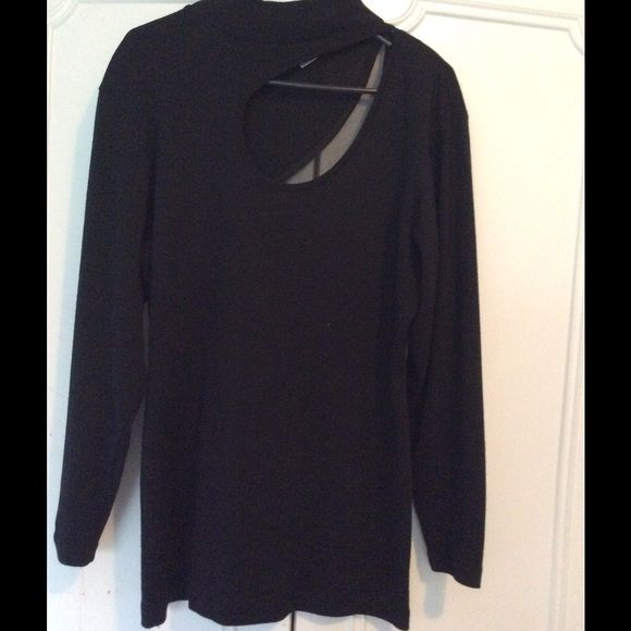 Black long sleeve tunic with tear drop cutout Black long sleeve tunic with tear drop cut out in the front and larger cut out in the back trimmed in sheer silk. Great for a cool night out Michelle Stuart Tops Tunics