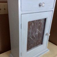 http://ourcraftymom.com/thrift-store-upcycle-yard-sale-cabinet-makeover/