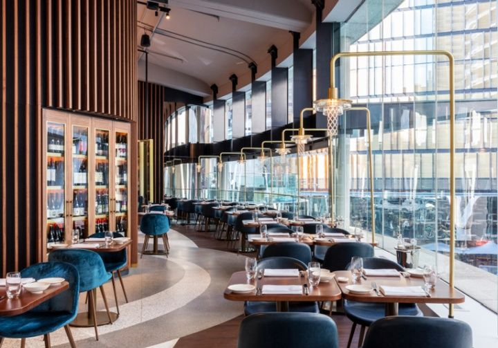 the restaurant is set across three of the buildings lower floors and boasts an interior