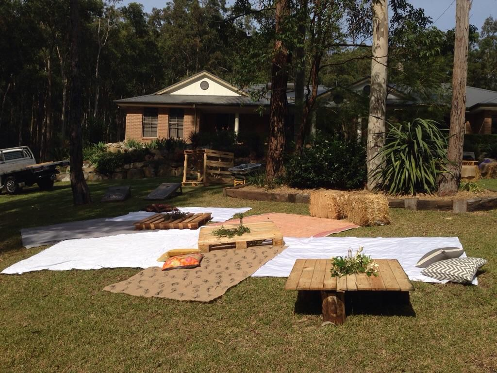 Backyard Engagement Party Picnic Area Pallet Tables Mix Match Sheets As Blankets