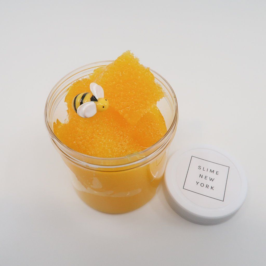 Orange-yellow slime with jelly cubes and a bee charm!