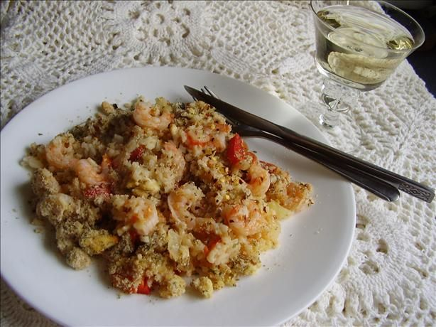 Greek Rice and Shrimp Bake With Feta Crumb Topping from Food.com:   								This Greek spin on the classic baked rice casserole calls for shrimp, but chicken can also be used. Cut three large boneless chicken breasts into cubes and brown first in oil in a hot skillet before adding to cooked rice. If you plan on doubling the recipe, use 2 1/2 cups (625 mL) rice and only 4 1/2 cups (1.125 L) stock.  From Food and Drink.